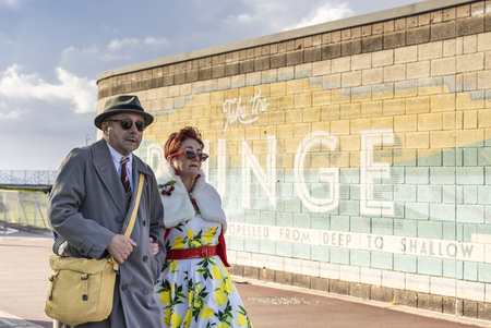MORECAMBE, UK - October 1, 2019: Senior couple in retro costume, participants of Vintage By The Sea festival in Morecambe, England.
