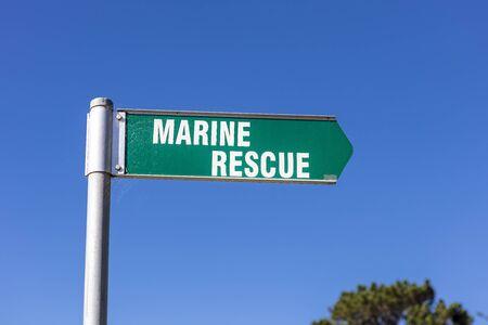 Green and white Marine Rescue sign on the coastline at Eden in Australia. Stock Photo