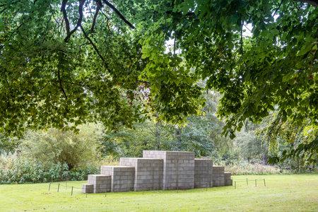 WAKEFIELD, YORKSHIRE, UK - October 19, 2019: Geometric sculpture by Sol Lewitt: 123454321 showcased in Yorkshire Sculpture Park near Wakefield.