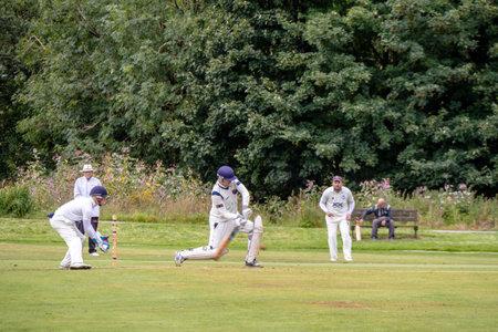 SADDLEWORTH, UK - September 5, 2020:  Cricket game at the village cricket club, batsman bowler action. 報道画像
