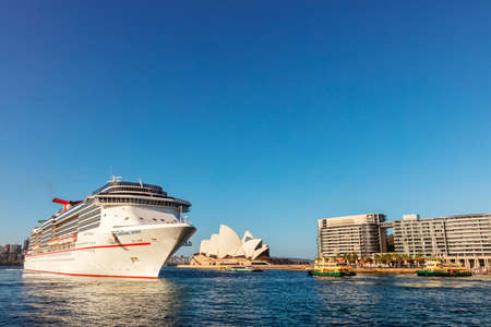 SYDNEY, AUSTRALIA - April 7, 2019: Large cruise liner at Sydney Harbour, with Opera House in background.