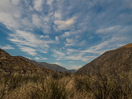 joshua: Blue cloudy sky over a valley Stock Photo