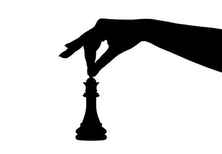 silhouette of a hand holding a chess piece isolated on white
