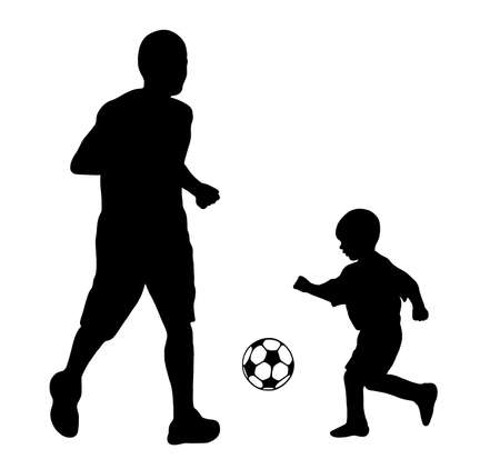 kids football: father and son playing soccer