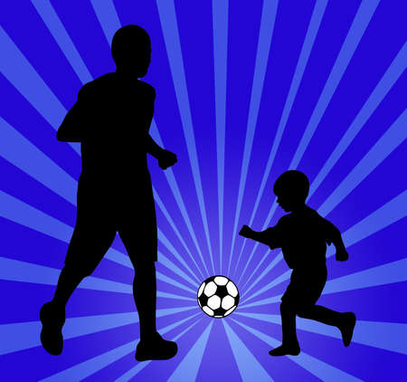father and son playing soccer photo