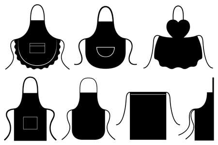 Set of different kitchen aprons isolated on white