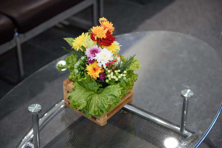 Interested flowers basket with vegetable