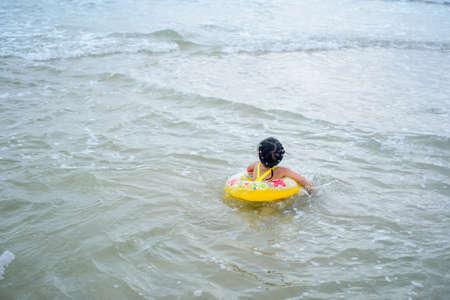 The children colorful swimming suit playing in the sea Stock Photo