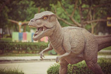 Vintage Dinosaur statue in the garden Stock Photo