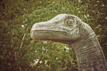Vintage Dinosaur Statue In The Garden Stock Photo, Picture And Royalty Free  Image. Image 78342431.