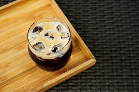 Refresh your day with a nice glass of nitro cold brew coffee. Stock Photo