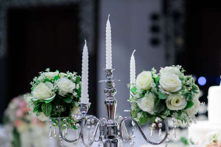 Candle holder with candle decorated with beautiful rose Prepared for wedding