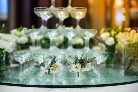 Wine glasses and beautiful flowers Was decorated for tonights event