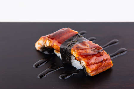 Sushi, the national food of Japan Made from good quality raw materials, fresh from the sea, making it look appetizing and delicious. Banco de Imagens