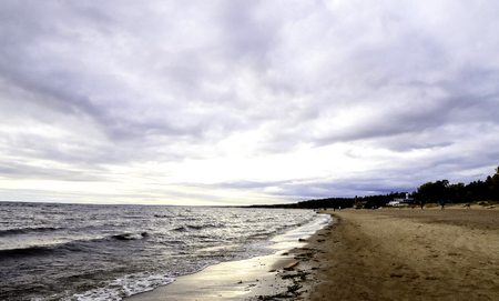 A view of the sea shore and dramatic storm clouds