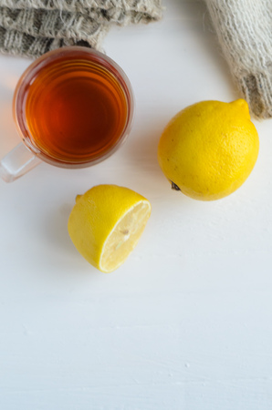 cup of tea , one and half lemon and woolen sweater. Imagens