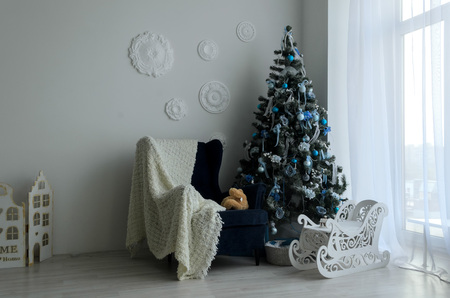 New Years holiday or celebration, the mood, Stylish Christmas minimalistic interior, christmas tree
