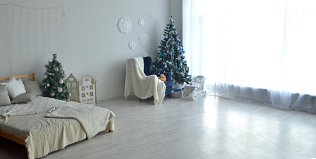 Stylish Christmas interior with a chair and an elegant sofa.