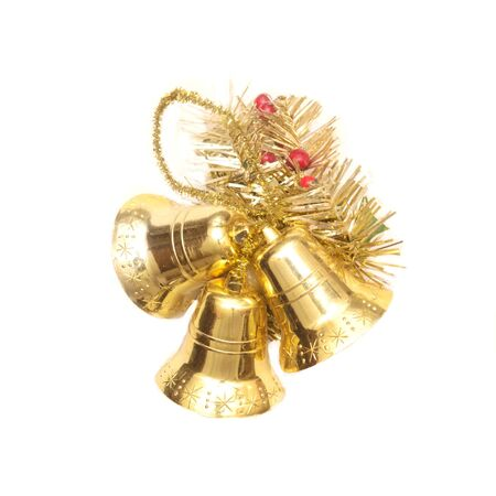 Three christmas golden bells isolated on white background