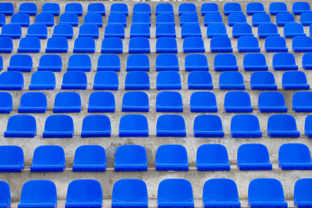 plastic blue seats on football stadium Stock Photo
