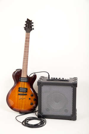 amp: guitar and aplifier with cable, on white Stock Photo