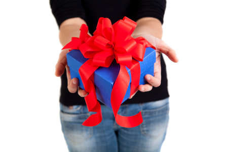 blue gift box with red ribbon in woman hands photo