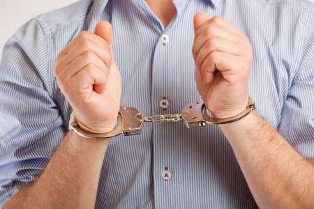 手錠逮捕された男のクローズ アップ 写真素材