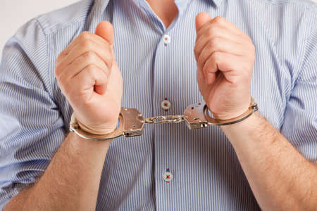 Close up of a man in handcuffs arrested   Stock Photo