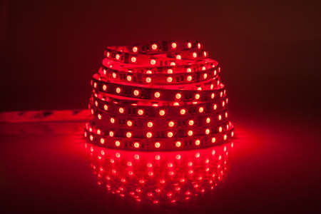 Red glowing LED garland, strip  photo