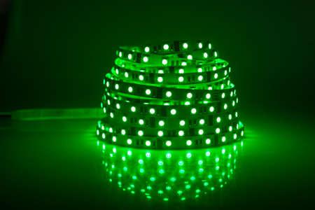 Green glowing LED garland, strip  photo