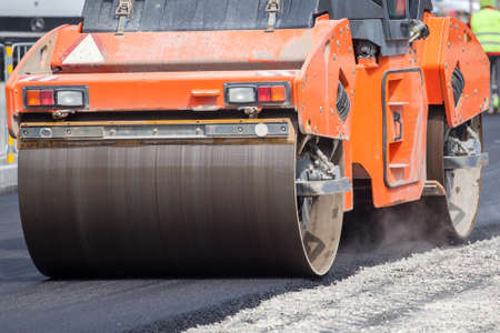 construction vibroroller: Large road-roller paving a road  Road construction