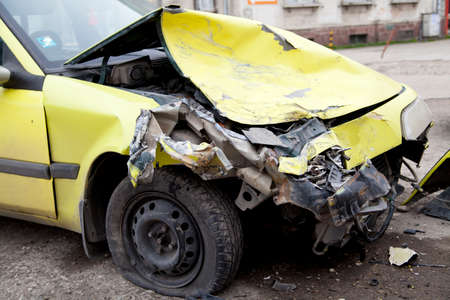 smashup: Traffic accident  Yellow crashed car