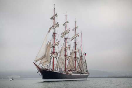 Old ship sailing in the sea photo