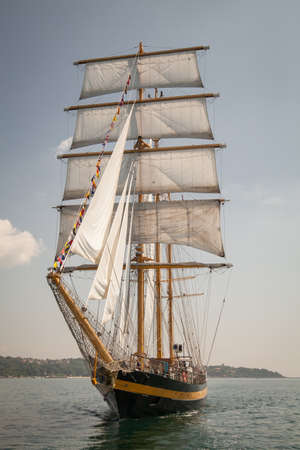 schooner: Old ship with white sales, sailing in the sea