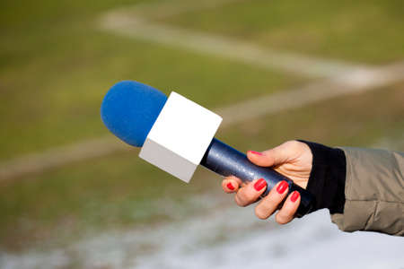 belonging to the caucasoid race: hand hold microphone for interview.