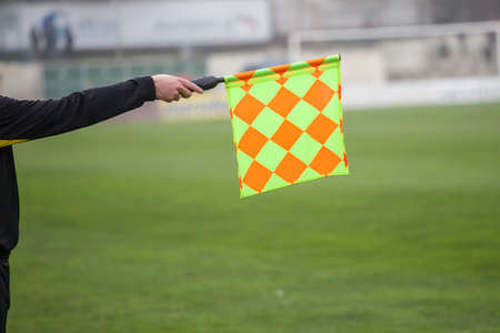 linesman: Soccer referee hold the flag. Offside trap