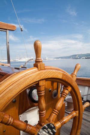 Old boat steering wheel from wood Standard-Bild