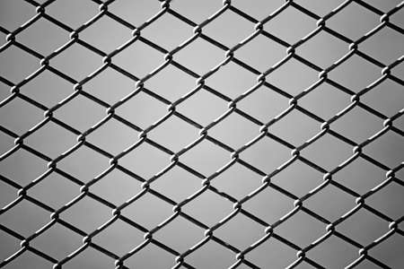 penal system: close up of wire fence in Black and White. Background