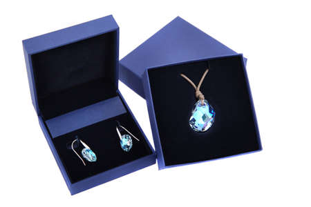 gewgaw: blue stone pendant and earring in blue present box isolated Stock Photo