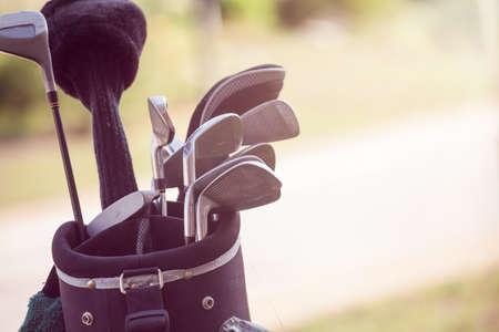golf club: set of golf clubs
