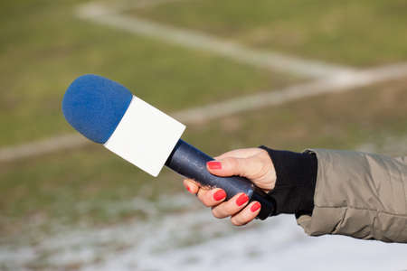 belonging to the caucasoid race: hand hold microphone for interview. Stock Photo