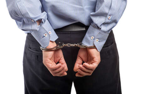 in bondage: Close up of a man in handcuffs arrested, isolated on white