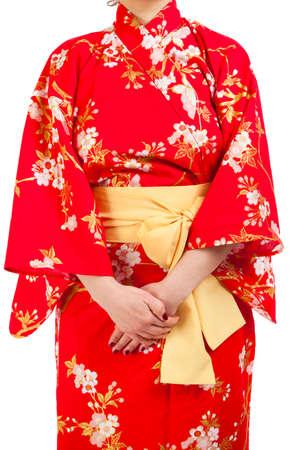 foreign bodies: woman wearing Japanese kimono, isolated on white background. Stock Photo