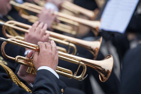 musicians are playing on trumpets Stock Photo