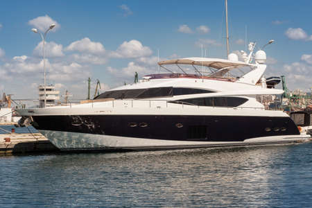 super yacht: Luxury yacht anchored in the port Stock Photo
