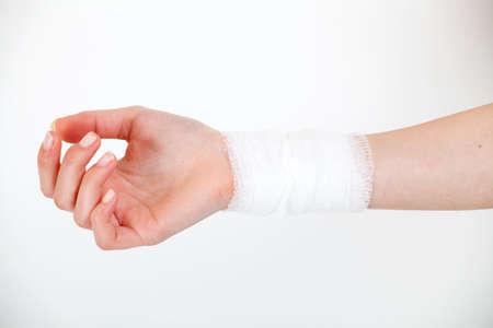 sprained joint: white medicine bandage on injury hand
