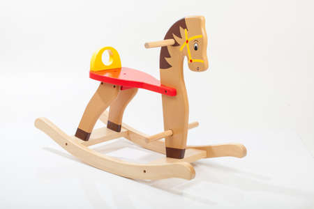 木製ロッキング ホース。子供のおもちゃ 写真素材
