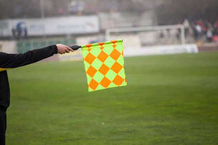 offside: Soccer referee hold the flag. Offside trap