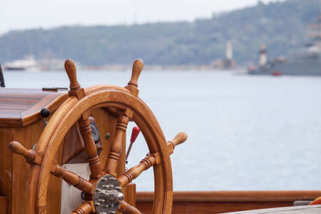 ships at sea: Old boat steering wheel from wood Stock Photo
