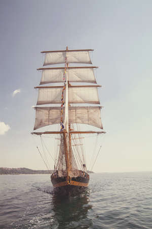 schooner: old historical ship (yacht) with white sails, sailing in the sea
